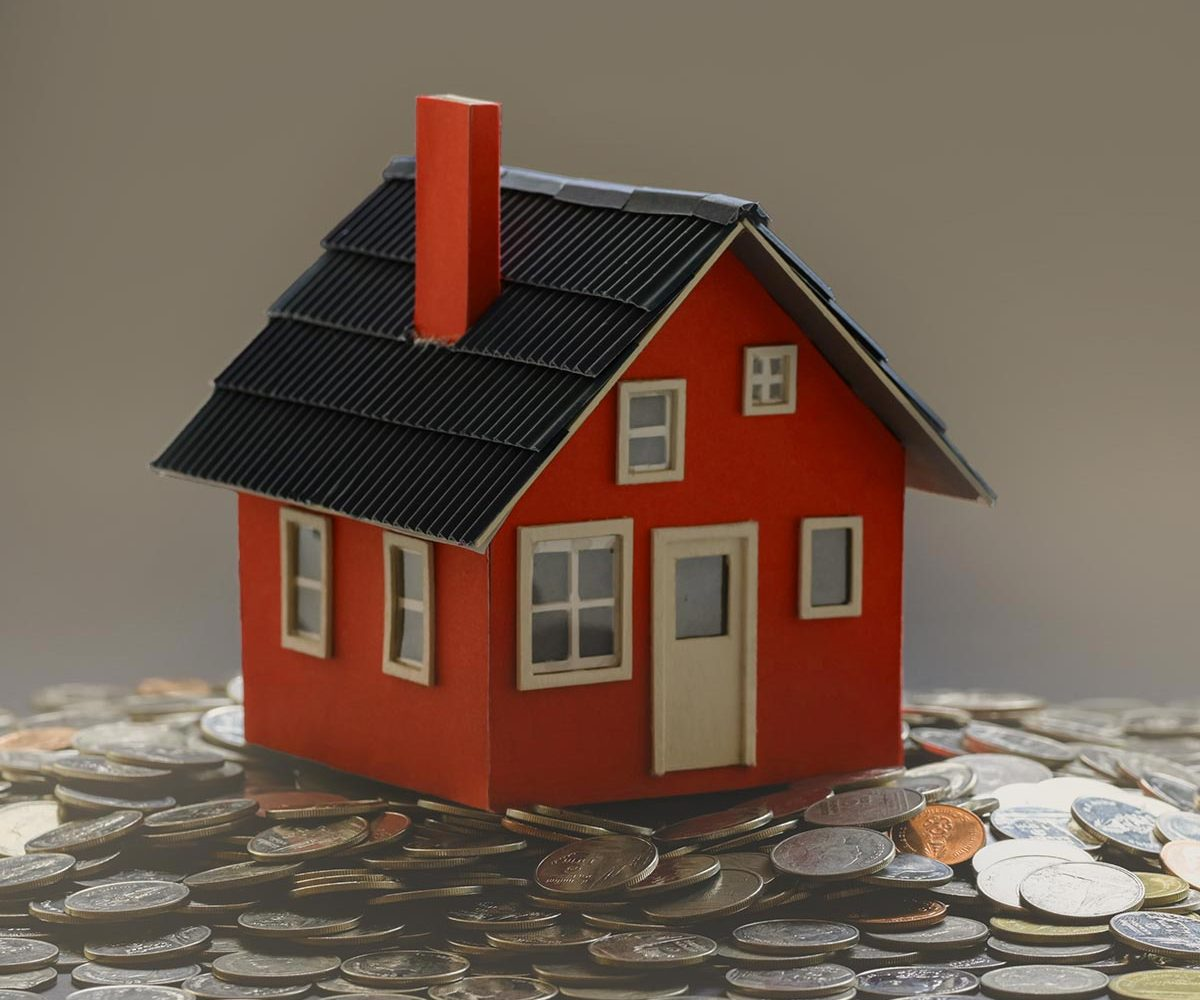 Real estate and property investment concept : small house model
